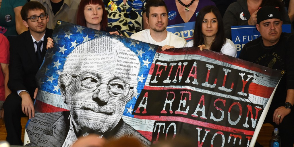 LAS VEGAS, NV - FEBRUARY 14: Supporters hold a poster during a campaign rally by Democratic presidential candidate Sen. Bernie Sanders (I-VT) at Bonanza High School on February 14, 2016 in Las Vegas, Nevada. Sanders is challenging Hillary Clinton for the Democratic presidential nomination ahead of Nevada's February 20th Democratic caucus. (Photo by Ethan Miller/Getty Images)