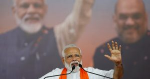 India's Prime Minister Narendra Modi gestures as he addresses his supporters during a public meeting in Ahmedabad